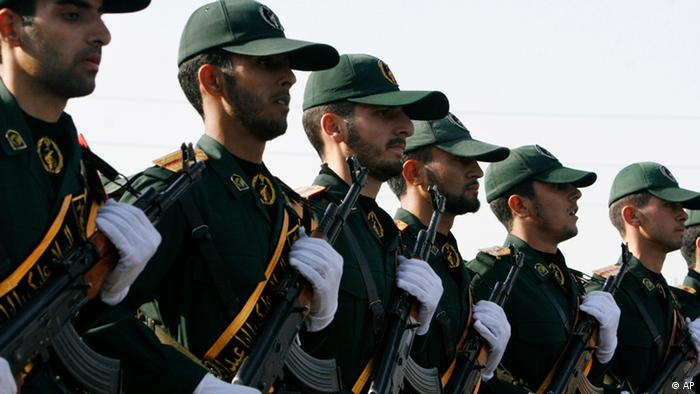 FILE - In this Sunday, Sept. 21, 2008 file photo, Iranian Revolutionary Guards members march during a parade ceremony, marking the 28th anniversary of the onset of the Iran-Iraq war (1980-1988), in front of the mausoleum of the late revolutionary founder Ayatollah Ruhollah Khomeini, just outside Tehran, Iran. Sometime early next year, a new voice is expected to join Iran's state-sanctioned media blitz: a full-service news agency with video, photos and print - run by Iran's Revolutionary Guards. (ddp images/AP Photo/Vahid Salemi, File)