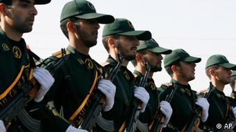 In this Sunday, Sept. 21, 2008 file photo, Iranian Revolutionary Guards members march during a parade ceremony, marking the 28th anniversary of the onset of the Iran-Iraq war (1980-1988), in front of the mausoleum of the late revolutionary founder Ayatollah Ruhollah Khomeini, just outside Tehran, Iran.