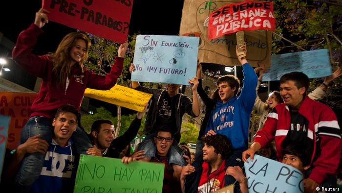 Students and teachers take part in a protest during a general teachers' strike against educational cuts imposed by the Spanish government in Almeria early May 22, 2012.