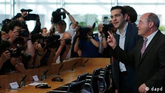 Alexis Tsipras, the leader of Greece's anti-austerity Syriza coalition, arrives for a press conference with leaders of Germany's Left Party Klaus Ernst, hidden, and Gregor Gysi, right, in Berlin, Germany, Tuesday, May 22, 2012. (AP Photo/Markus Schreiber)