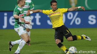 Shinji Kagawa, then playing for Borussia Dortmund, winds up for a left-footed shot in last season's German Cup semifinal against Fürth