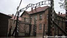 The gate at Auschwitz with the words 'Arbeit Macht Frei'
