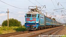 Passenger train hauled by electric locomotive © Leonid Andronov #40250755