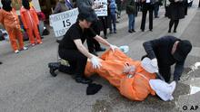 Mike Morice, center, and other members of World Can't Wait group perform a live waterboarding demonstration outside the Spanish Consulate in Manhattan to urge prosecution in Spain of the alleged involvement of Bush administration officials in the torture of terror suspects, Thursday, April 23, 2009 in New York. (ddp images/AP Photo/Mary Altaffer)