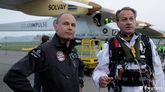 Solar Impulse project president and pilot Bertrand Piccard (L) and CEO and pilot Andre Borschberg talks before take off at Payerne airport May 24, 2012.