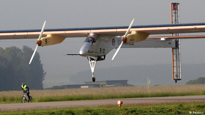 A Solar Impulse aircraft takes off at Payerne airport May 24, 2012. The Solar Impulse HB-SIA prototype aircraft, which has 12,000 solar cells built into its 64.3 metres (193 feet) wings, attempted its first intercontinental flight from Payerne to Rabat in Morocco with a few days for a technical stop and a change of pilot in Madrid. This flight will act as a final rehearsal for the 2014 round-the-world flight. REUTERS/Denis Balibouse (SWITZERLAND - Tags: TRANSPORT SCIENCE TECHNOLOGY SOCIETY)