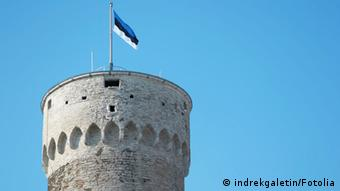 A symbolic picture of a castle in Estonia with the flag.