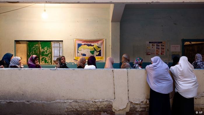 Egyptian women wait in line to vote in the presidential election