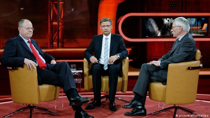 Talk show involving former finance minister Peer Steinbrück (SPD), host Günther Jauch and former Berlin finance officer Thilo Sarrazin (SPD, l-r) Photo: Florian Schuh dpa/lbn