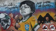 Mural showing a crying boy in a Brazilian jersey and a football resembling a skull next to the words thank you Fifa