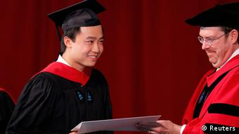 Bo Guagua, son of fallen Chinese politician Bo Xilai, receives his masters degree in public policy from Senior Lecturer John Donohue (R) at the John F. Kennedy School of Government during the 361st Commencement Exercises at Harvard University in Cambridge, Massachusetts May 24, 2012. Bo graduated from Harvard University's Kennedy School of Government on Thursday, capping a tumultuous academic year that also placed him in the center of his homeland's biggest leadership crisis in two decades. REUTERS/Brian Snyder (UNITED STATES - Tags: EDUCATION POLITICS)