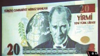 An image of a 20 Lira note in Turkey's new currency, the New Turkish Lira, is shown at a news conference unveiling the new currency in Ankara on Monday, Oct. 25, 2004. One million Turkish lira will become one New Turkish lira, under the new currency, which will be legal tender as of Jan. 1, 2005. Mustafa Kemal Ataturk, the founder of modern Turkey, is featured on the note. (AP Photo/Burhan Ozbilici)
