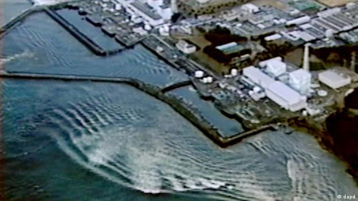 Backrush of tsunami hitting Fukushima Dai-ichi nuclear power plant in Okumamachi, Fukushima Prefecture, Japan, is seen on March 11, 2011