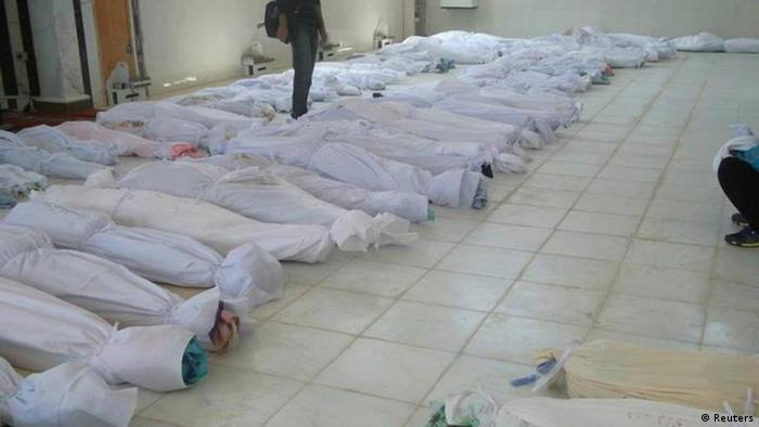 The bodies of whom anti-government protesters say were killed by government security forces lie on the ground at Ali Bin Al Hussein mosque in Huola, near Homs May 26, 2012. A Syrian artillery barrage killed more than 90 people, including dozens of children, in the worst violence since the start of a U.N. peace plan to staunch the flow of blood from Syria's uprising, activists said on Saturday. REUTERS/Houla News Network/Handout (SYRIA - Tags: CIVIL UNREST POLITICS) FOR EDITORIAL USE ONLY. NOT FOR SALE FOR MARKETING OR ADVERTISING CAMPAIGNS. THIS IMAGE HAS BEEN SUPPLIED BY A THIRD PARTY. IT IS DISTRIBUTED, EXACTLY AS RECEIVED BY REUTERS, AS A SERVICE TO CLIENTS