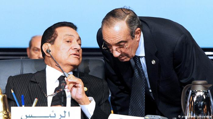 A file photo dated 19 January 2011, shows the then Egyptian President Hosni Mubarak (L) talking to his Chief of the Presidential Staff Zakaria Azmi (R) during the Economic, Development and Social summit held in the Red Sea resort of Sharm el-Sheikh, Egypt.