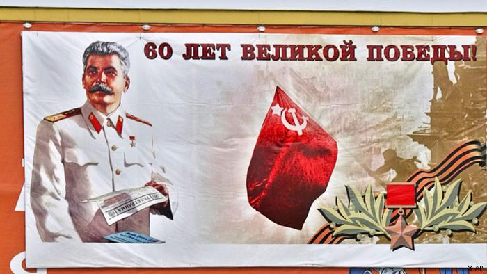 A poster features Soviet leaderJosef Stalin standing gloriously against the backdrop of a Red Army soldier who raises a red Soviet flag on top of the Reichstag in Berlin, and reads '60 Years of the Great Victory,' in Moscow, Friday, May 6, 2005. Stalin, whom historians denounce as a tyrant responsible for the deaths of millions of his own people, appears to be making a comeback under President Vladimir Putin with monuments in the works and criticism muted. The sign under the poster reads Computers. (ddp images/AP Photo/Sergei Grits).