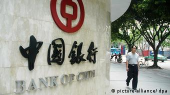 A Chinese man walks past a branch of Bank of China (BOC) in Fuzhou city, southeast Chinas Fujian province, July 11, 2008.Two major Chinese banks, Industrial Bank of China (ICBC) and Bank of China (BOC) that own US$8 billion in Fannie Mae and Freddie Mac securities said they welcomed the US governments decision to help the troubled mortgage lenders. BOC said last month it owned US$7.5 billion in Fannie and Freddie bonds after cutting its holdings by about 25%. The bank also held US$5.2 billion in mortgage-backed securities guaranteed by the two agencies. ICBC said in late August it owned US$465 million in Fannie and Freddie debt, plus US$2.2 billion in mortgage-backed securities issued by the two companies. It said that was just 0.20% of its total holdings. Both state-owned banks declined to say whether they expect to lose money on their securities. +++(c) dpa - Report+++