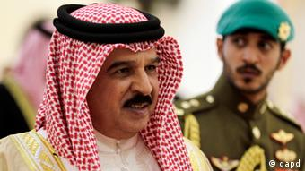 Bahrain's King Hamed bin Isa Al Khalifa, accompanied by his son, Prince Khalid bin Hamad Al Khalifa, right,