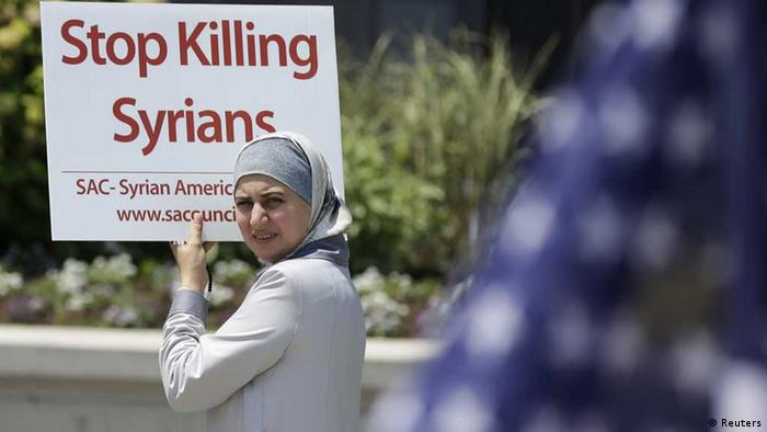 Protester demonstrating against violence in Syria