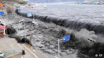 In this March 11, 2011, photo release Thursday, May 19 by Tokyo Electric Power Co. waves of tsunami come toward tanks of heavy oil for the Unit 5 of the Fukushima Dai-ichi nuclear complex in Okuma, Fukushima Prefecture, northeastern Japan. (ddp images/AP Photo/Tokyo Electric Power Co.)