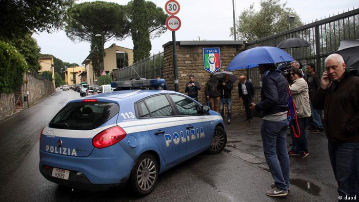 An Italian police car arrives at the Coverciano site center where the Italy national team is training, near Florence