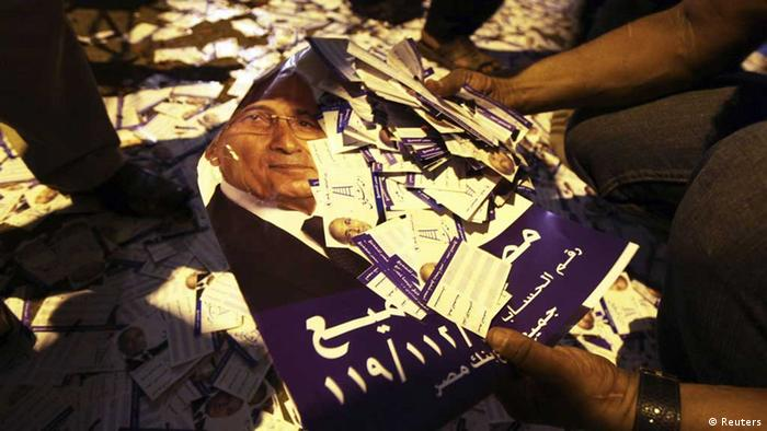 Flyers of Egyptian presidential candidate and former prime minister Ahmed Shafiq are seen on the ground outside his campaign headquarters