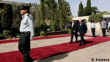 Israel's President Peres walks with his German counterpart Gauck during a welcoming ceremony in Jerusalem