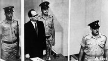 FILE - The 1961 file photo shows Adolf Eichmann standing in his glass cage, flanked by guards, in the Jerusalem courtroom during his trial in 1961 for war crimes committed during World War II. The original glass booth is now shown the first time outside Israel as part of the special exhibition 'Facing Justice - Adolf Eichmann on Trial' at the documentation center placed at the former Gestapo headquartes in Berlin, Germany. (Foto:AP/dapd)