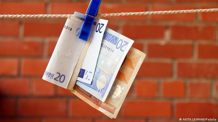 Banknotes hanging from washing line