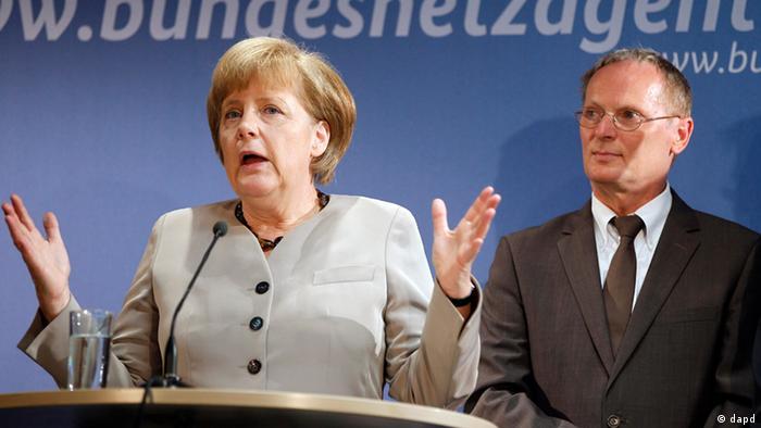 Merkel y Jochen Homann, presidente de la Agencia Federal de Redes Eléctricas.
