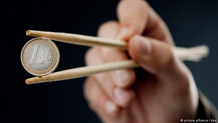 euro coin with chopsticks