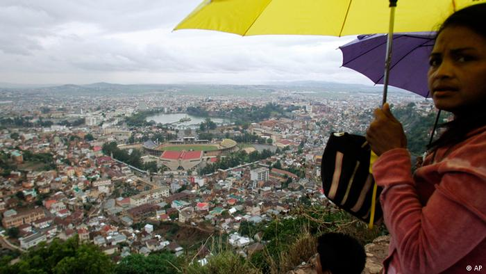 People look at the view of the city in Antananarivo, Madagascar Sunday, Nov. 21, 2010. An attempted coup on this troubled Indian Ocean island has been defused without bloodshed, the Madagascar regime's prime minister said. (AP Photo/Themba Hadebe)