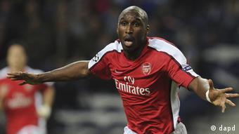 Sol Campbell as he celebrates after scoring against Porto in a Champions League match