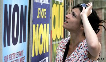 Woman looking at European referendum posters