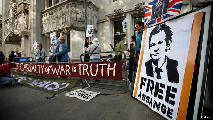 Supporters of WikiLeaks founder Julian Assange, hold placards and banners bearing images of him before the verdict was given in his extradition case at the Supreme Court in London, Wednesday, May 30, 2012