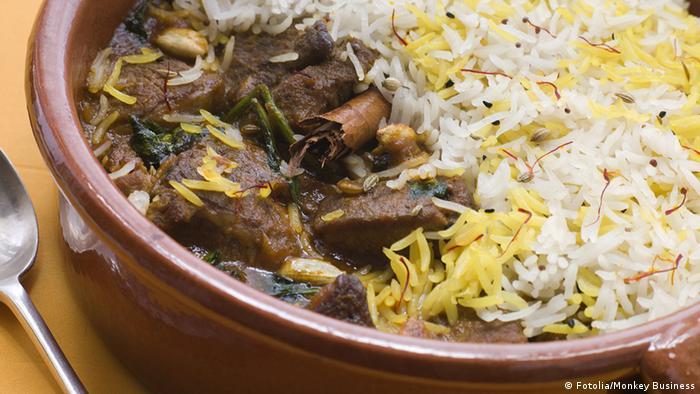 Iran Essen Gericht Lamm Biryani mit Basmati Reis und Löffel