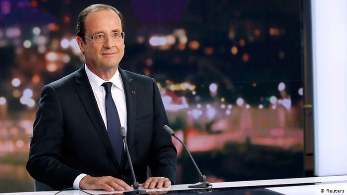 France's President Francois Hollande is seen at the French Television France 2 studios ahead of his appearance on their prime time evening news programme in Paris May 29, 2012. REUTERS/Thomas Samson/Pool (FRANCE - Tags: POLITICS MEDIA)