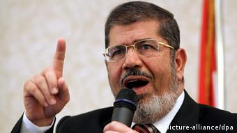 Close-up of Morsi talks during a press conference
