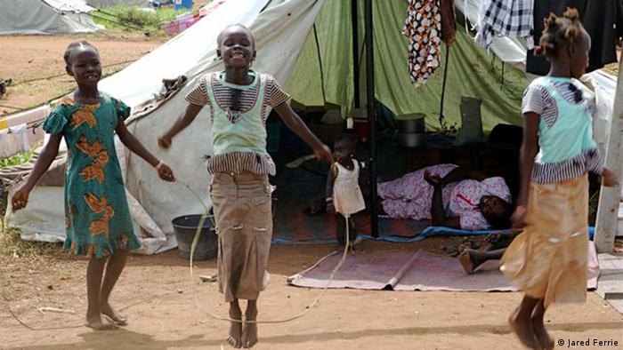 2288 Children skip rope in a temporary camp for returnees on the outskirts of Juba