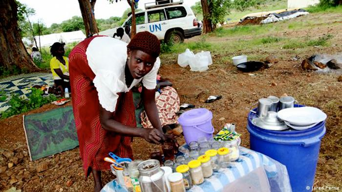 Betty Foni prepares tea at her tea stand in a temporary camp for returnees on the outskirts of Juba