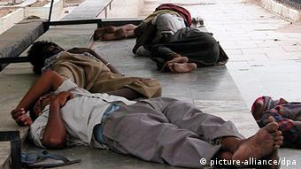 Unidentified homeless people sleep on the foothpath in New Delhi, Thursday 24 June, 2004. (Photo: Money Sharma EPA dpa)