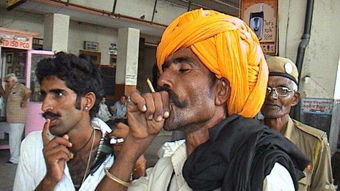 Indian men shown smoking cigarettes in the Indian city of Jaipur.