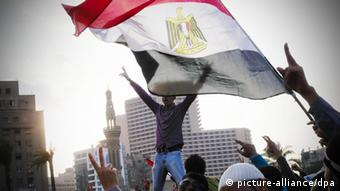 Demonstrators at Tahrir Square with Egyptian flag