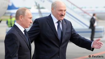 Belarussian President Alexander Lukashenko (R) walks with his Russian counterpart Vladimir Putin at the national airport in Minsk May 31, 2012. Putin arrived in Belarus for a two-day official visit. REUTERS/Victor Drachev/Pool (BELARUS - Tags: POLITICS)