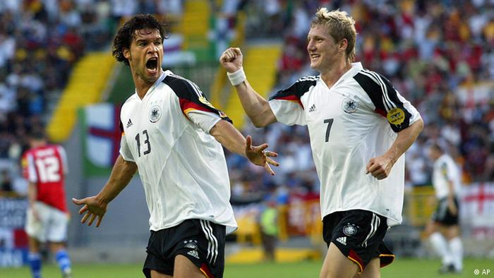 Germany's Michael Ballack, left, celebrates with teammate Bastian Schweinsteiger after scoring the opening goal during the Euro 2004 Group D soccer match between Germany and the Czech Republic at the Jose Alvalade Stadium in Lisbon, Portugal, Wednesday June 23, 2004.