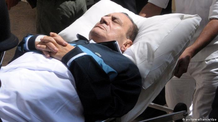 epa03244987 (FILE) A file photo dated 07 September 2011 shows former Egyptian president Hosni Mubarak on his bed while being taken to the courtroom for another session of his trial in Cairo, Egypt. Mubarak on 02 June 2012 is due to hear the verdict in his trial over the killing of peaceful protesters and corruption. If convicted, Mubarak, 84, could be sentenced to death or life imprisonment. Mubarak is the first Egyptian ruler ever to be put on trial. His two sons, Alaa and Gamal, interior minister, Habib al-Adli, and six former security aides are standing the same trial. EPA/STRINGER
