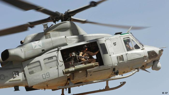 A United States Marine armed Super Huey helicopter flies above Forward Operating Base Edi, in the volatile Helmand Province of southern Afghanistan, Friday, May 6, 2011. (AP Photo/Kevin Frayer)