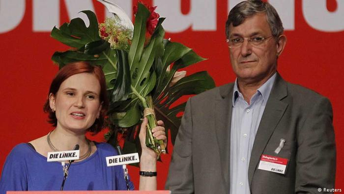 Katja Kipping (L) and Bernd Riexinger, new leaders of Germany's left wing Die Linke party, stand on stage