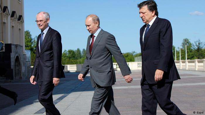 Russian President Vladimir Putin, center, European Union Commission President Jose Manuel Barroso, right, and European Council President Herman Van Rompuy walk together during the Russia EU Summit at the Konstantin palace in St.Petersburg, Russia, Monday, June 4, 2012
