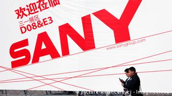 --File-- Visitors walk past an advertisement of Sany Heavy Industry Co., parent company of Sany Heavy Equipment International Holdings, during the 2010 International Trade Fair for Construction Machinery, Building Material Machines, Construction Vehicles and Equipment, known as BAUMA China 2010, at Shanghai New International Expo Centre (SNIEC) in Shanghai, China, November 24, 2010. The owners of Hong Kong-listed Sany Heavy Equipment International Holdings Co. Ltd. are planning to raise $300 million from the sale of shares in Brazil, via Brazilian depositary receipts to be listed on the Brazilian stock exchange, a senior company executive said Tuesday (February 22, 2011).